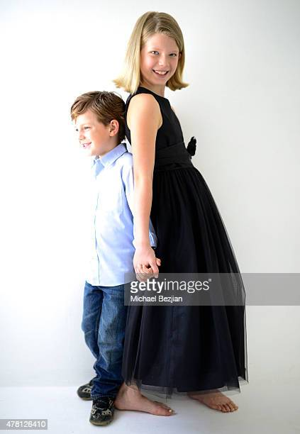 Kayden Everhart and JoAnn Ferro pose for portrait at The SAP the Starving Artists Project portraits on June 22 2015 in Los Angeles California