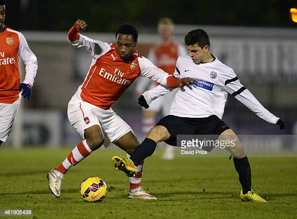 Kayeln Hinds of Arsenal is challenged by Josh Castiglione of Royston during the match between Arsenal U18 and Royston Town U18 in the FA Youth Cup...