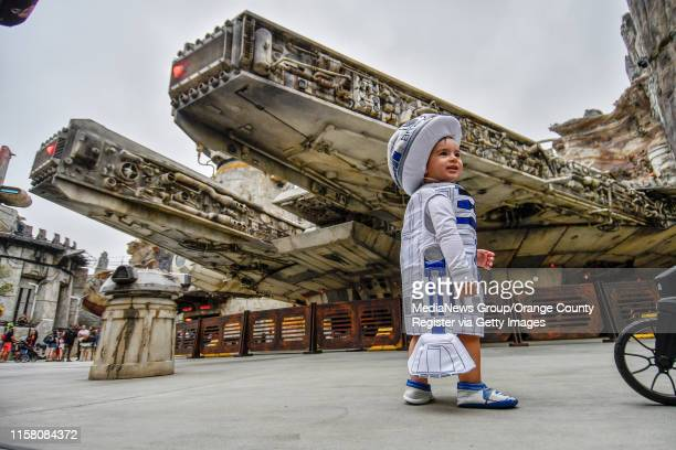 """Kayes dons a R2D2 costume in front of the Millennium Falcon during the first day without needing a reservation at Star Wars: Galaxy""""u2019s Edge..."""