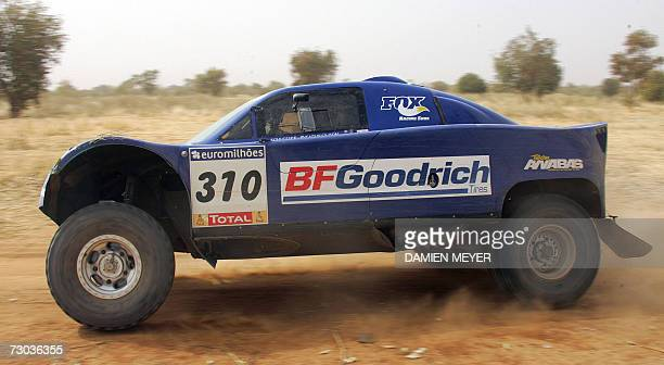 France's JeanLouis Schlesser drives his FordSchlesser during the twelveth stage of the 29th Dakar rally between Ayoun El Atrous and Kayes 18 January...