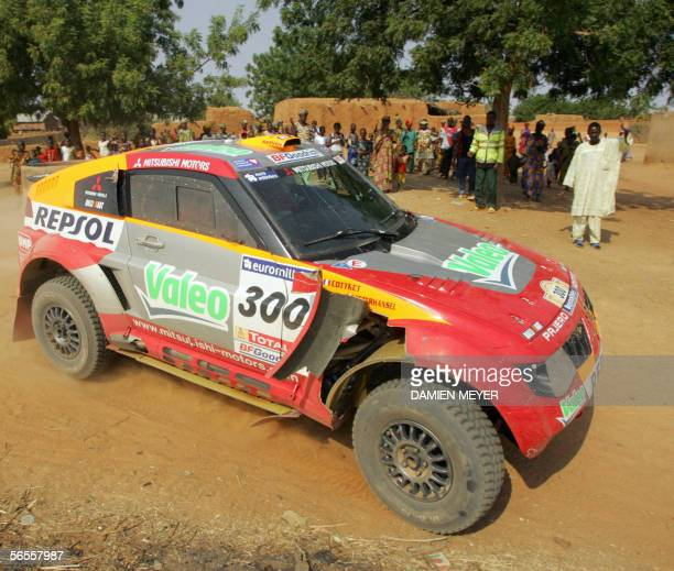 France's Stephane Peterhansel steers his car in a village to finish third during the tenth stage of the 28th Dakar Rally between Kiffa and Kayes 10...