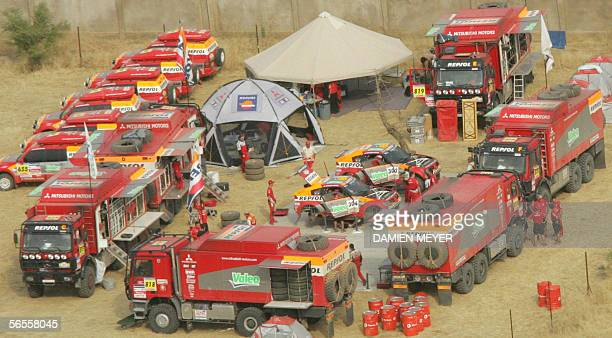 General view of Mitsubishi bivouac at Kayes where mechanics work on Frenchmen Stephane Peterhansel and Luc Alphand's cars after the tenth stage of...