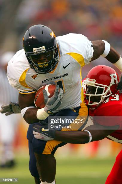 Kay-Jay Harris of the West Virginia Mountaineers is tackled by Ron Girault of the Rutgers University Scarlet Knights in the second quarter on October...