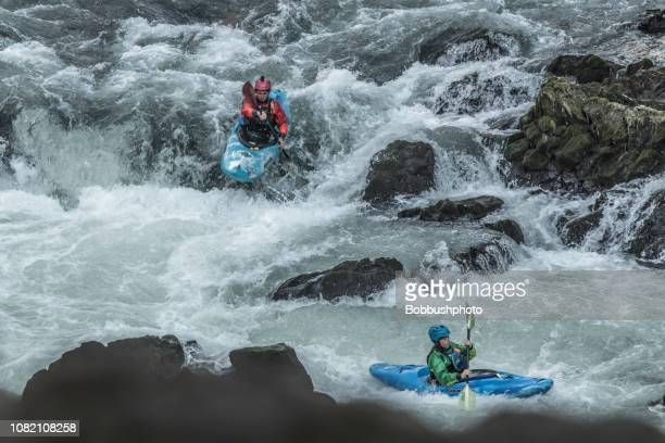 kayking white water rapids of benham falls on the deschutes river near bend, oregon - swift river stock photos and pictures