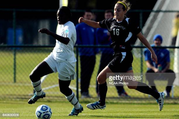 Kayla Addison of GVSU and Derith Fernandes of Saint Rose battle for the ball during the Division II Women's Soccer Championship held at the Ashton...