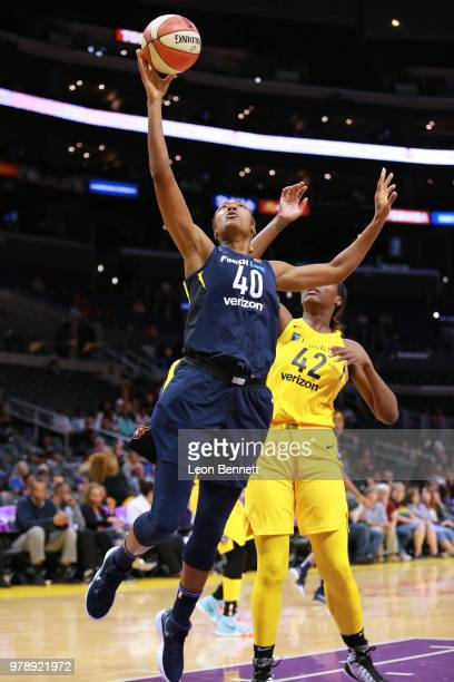 Kayla Alexander of the Indiana Fever handles the ball against Jantel Lavender of the Los Angeles Sparks during a WNBA basketball game at Staples...