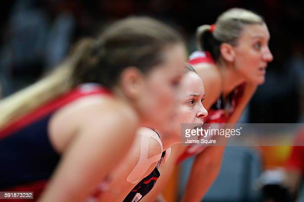 Kayla Banwarth of United States is seen between her teammates while taking on Serbia while taking on Serbia in the Women's Volleyball Semifinal match...