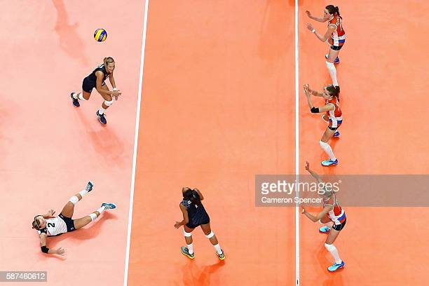 Kayla Banwarth of United States plays a shot off the court during the Women's Preliminary Pool B match between the Netherlands and the United States...