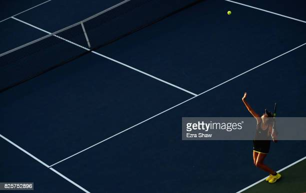 Kayla Day of the United States serves to Garbine Muguruza of Spain during Day 3 of the Bank of the West Classic at Stanford University Taube Family...
