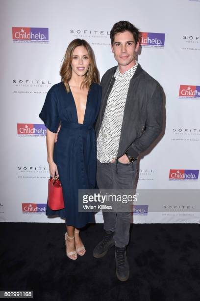 Kayla Ewell and Tanner Novlan attend Childhelp Hollywood Heroes on October 18 2017 in Beverly Hills California