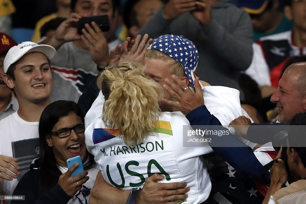 Kayla Harrison celebrates after defeating France's Audrey Tcheumeo during their women's -78kg judo contest gold medal match of the Rio 2016 Olympic Games in Rio de Janeiro on August 11, 2016. / AFP / Jack GUEZ