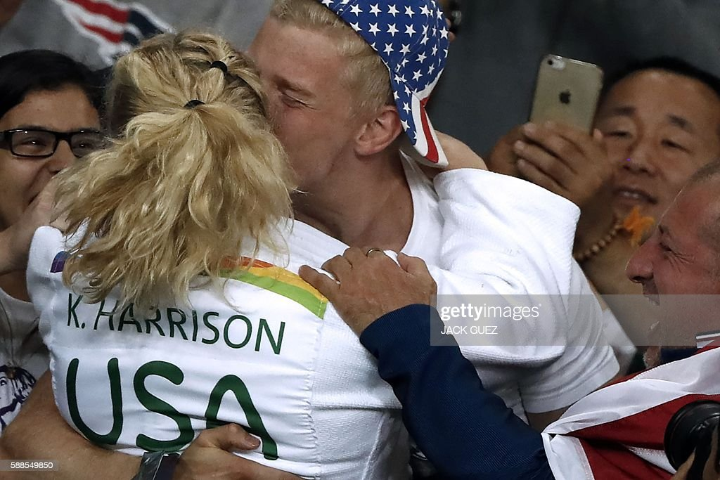 US Kayla Harrison celebrates after defeating France's Audrey Tcheumeo during their women's -78kg judo contest gold medal match of the Rio 2016 Olympic Games in Rio de Janeiro on August 11, 2016. / AFP / Jack GUEZ