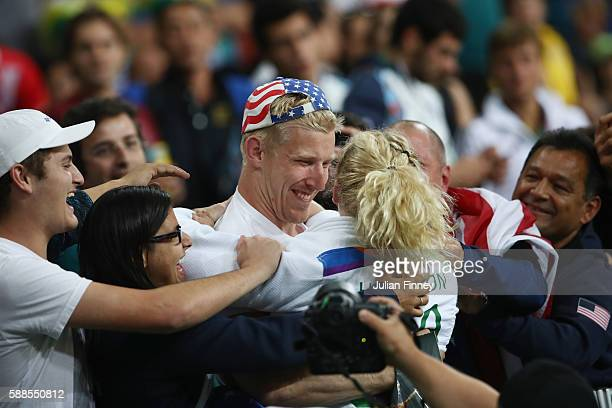 Kayla Harrison of the United States celebrates after defeating Audrey Tcheumeo of France during the women's 78kg gold medal judo contest on Day 6 of...