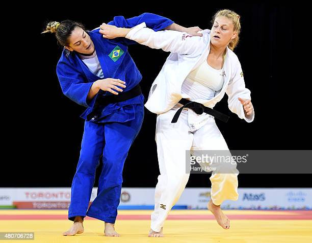 Kayla Harrison of the United States of America and Mayra Aguiar of Brazil compete in the minus 100kg judo gold medal match during the 2015 Pan Am...
