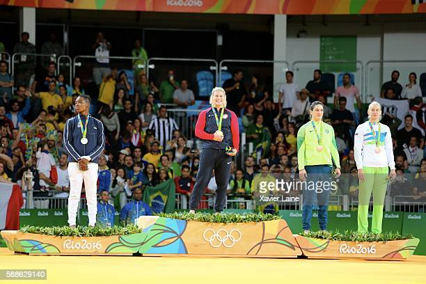 Kayla Harrison of United States celebrate his gold medal with Mayra Aguiar of Brazil and Audrey Tcheumeo of France after the final women's 78kgs at...