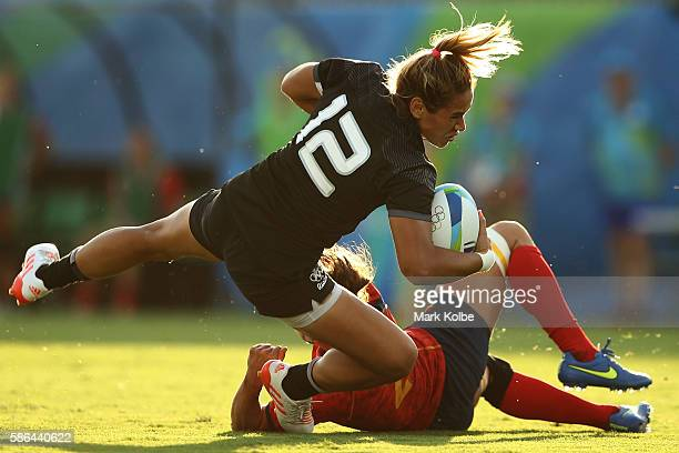 Kayla Mcalister of New Zealand is tackled by Paula Medin of Spain during a Women's Pool B rugby match between New Zealand and Spain on Day 1 of the...