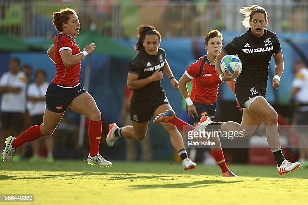 Kayla Mcalister of New Zealand runs with the ball to score a try during a Women's Pool B rugby match between New Zealand and Spain on Day 1 of the...