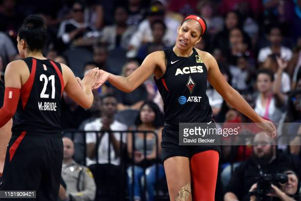 Kayla McBride and A'ja Wilson of the Las Vegas Aces high five during the game against the Seattle Storm on June 25 2019 at the Mandalay Bay Events...