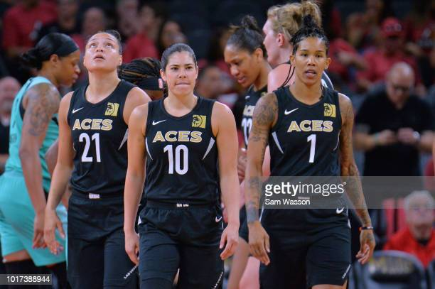 Kayla McBride Kelsey Plum and Tamera Young of the Las Vegas Aces stand on the court during their game against the New York Liberty at the Mandalay...