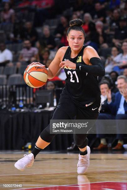 Kayla McBride of the Las Vegas Aces dribbles against the New York Liberty during their game at the Mandalay Bay Events Center on August 15 2018 in...