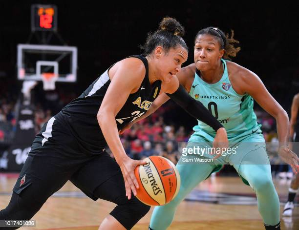 Kayla McBride of the Las Vegas Aces drives against Marissa Coleman of the New York Liberty during their game at the Mandalay Bay Events Center on...