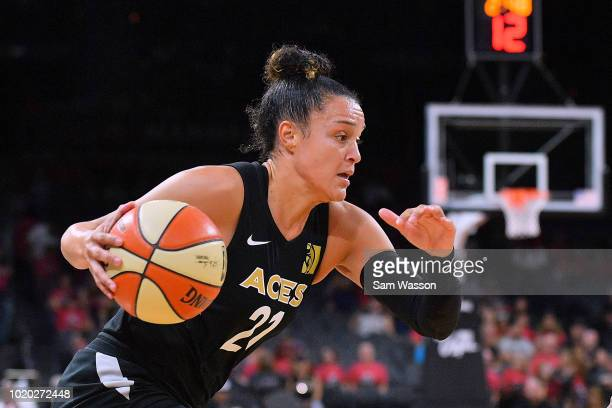 Kayla McBride of the Las Vegas Aces drives against the New York Liberty during their game at the Mandalay Bay Events Center on August 15 2018 in Las...