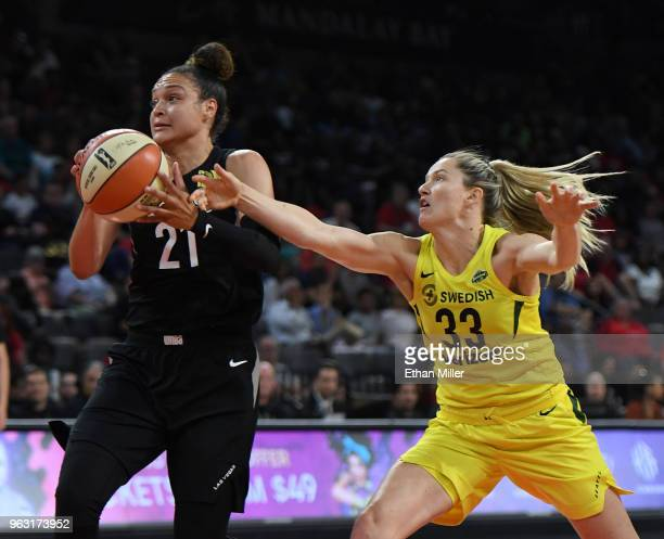 Kayla McBride of the Las Vegas Aces drives to the basket against Sami Whitcomb of the Seattle Storm during the Aces' inaugural regularseason home...