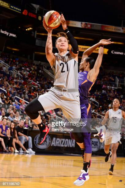 Kayla McBride of the Las Vegas Aces goes to the basket against the Phoenix Mercury on June 10 2018 at Talking Stick Resort Arena in Phoenix Arizona...