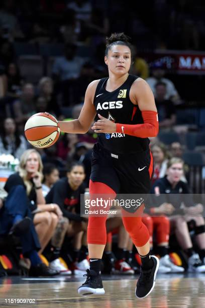 Kayla McBride of the Las Vegas Aces handles the ball against the Seattle Storm on June 25 2019 at the Mandalay Bay Events Center in Las Vegas Nevada...