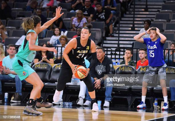 Kayla McBride of the Las Vegas Aces looks to drive against Kia Nurse of the New York Liberty during their game at the Mandalay Bay Events Center on...