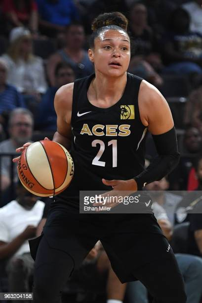 Kayla McBride of the Las Vegas Aces looks to pass against the Seattle Storm during the Aces' inaugural regularseason home opener at the Mandalay Bay...