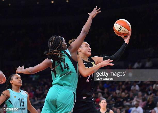 Kayla McBride of the Las Vegas Aces shoots a layup against Sugar Rodgers of the New York Liberty during their game at the Mandalay Bay Events Center...