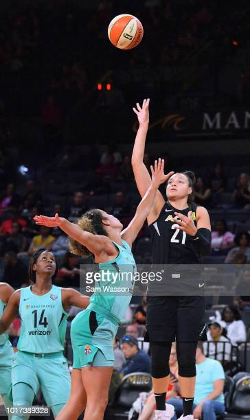 Kayla McBride of the Las Vegas Aces shoots against Kia Nurse of the New York Liberty during their game at the Mandalay Bay Events Center on August 15...