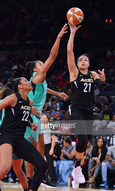 Kayla McBride of the Las Vegas Aces shoots against Kiah Stokes of the New York Liberty as A'ja Wilson of the Aces looks on during their game at the...