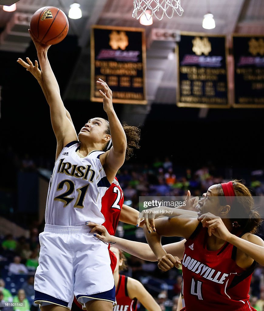 Kayla McBride #21 of the Notre Dame Fighting Irish puts the ball up against the Louisville Cardinals at Purcel Pavilion on February 11, 2013 in South Bend, Indiana. Notre Dame defeated Louisville 93-64.