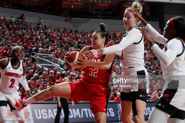 Kayla McBride of the USA Women's National team grabs a rebound against Kylee Shook of the Louisville Cardinals during an exhibition game at KFC YUM...