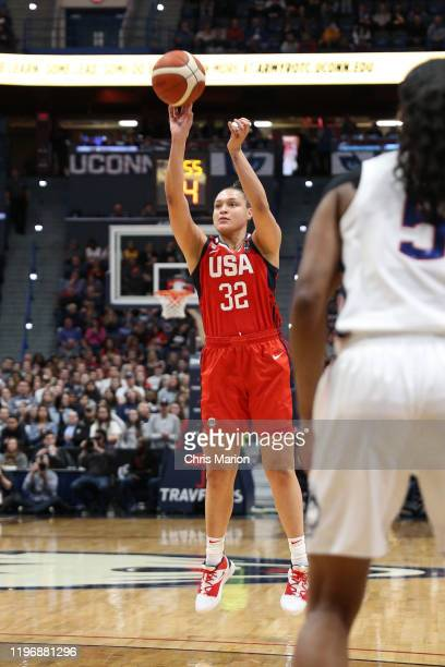 Kayla McBride of the USA Women's National Team shoots three point basket against the UConn Huskies on January 27 2020 at XL Center in Hartford...