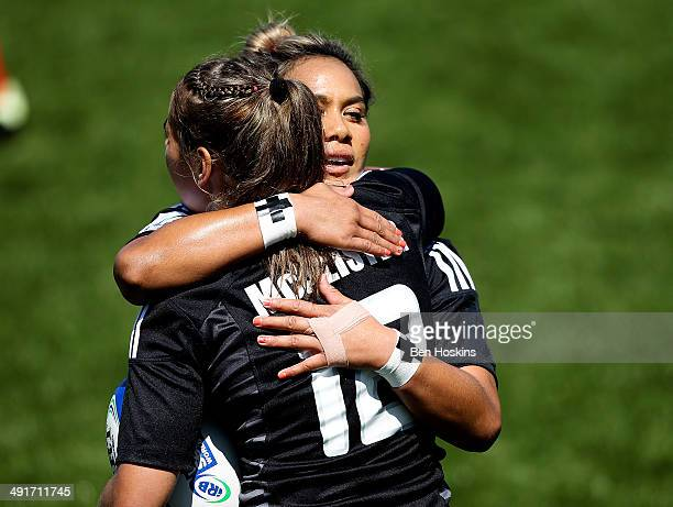Kayla McCalister of New Zealand is congratulated by Huriana Manuel after scoring a try during the IRB Women's Sevens World Series match between New...