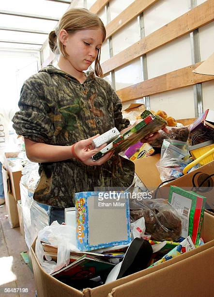 Kayla Moore 11yearsold looks through boxes loaded with toys stacked in the back of a truck December 25 2005 in Arabi Louisiana in St Bernard Parish...