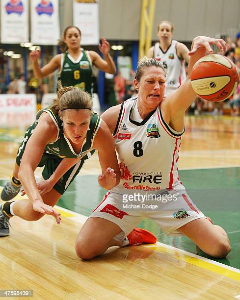 Kayla Pederson of the Ranges and Suzy Batkovic of the Fire contest for the ball during the WNBL Preliminary Final match between the Dandenong Rangers...