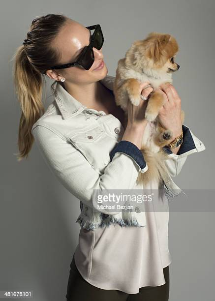 Kayla Quick poses for Portraits For Pooches on March 30 2014 in Beverly Hills California
