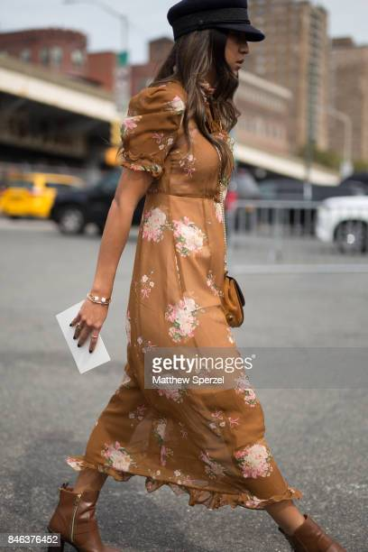 Kayla Seah is seen attending Coach during New York Fashion Week wearing a brown dress on September 12 2017 in New York City