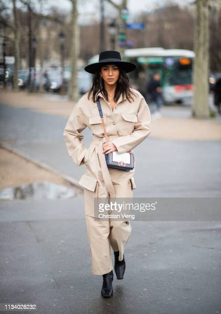 Kayla Seah is seen wearing beige overall outside Chanel during Paris Fashion Week Womenswear Fall/Winter 2019/2020 on March 05 2019 in Paris France