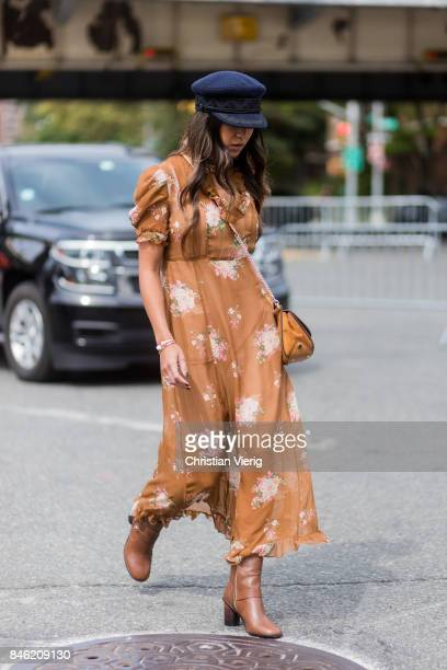 Kayla Seah wearing a brown dress flat cap seen in the streets of Manhattan outside Coach during New York Fashion Week on September 12 2017 in New...