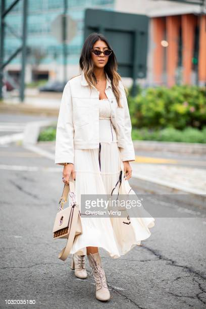 Kayla Seah wearing creme white dress and jacket Fendi bag boots seen outside Coach during New York Fashion Week Spring/Summer 2019 on September 11...
