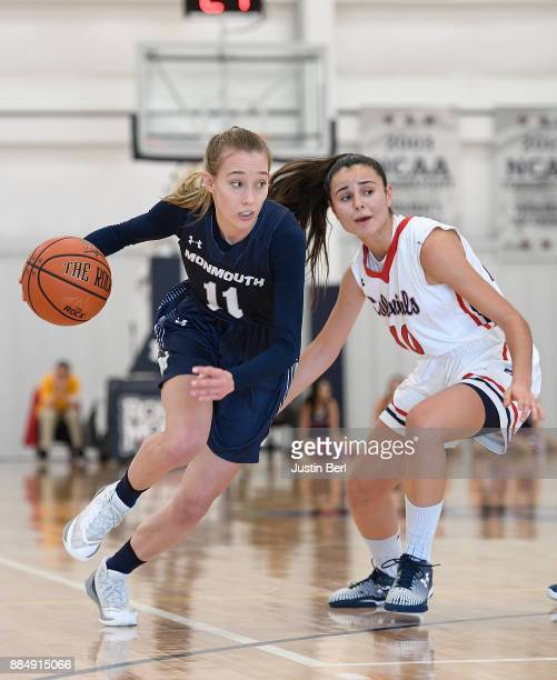 Kayla Shaw of the Monmouth Hawks drives to the basket against Laura Carrasco of the Robert Morris Colonials in the second half during the game at...
