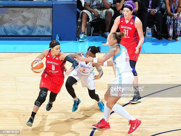 Kayla Thornton of the Washington Mystics handles the ball against Roneeka Hodges and Erika de Souza of the Atlanta Dream at the Philips Center on...