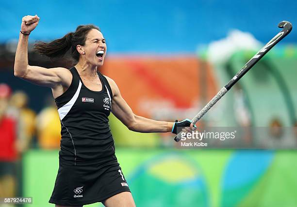Kayla Whitelock of New Zealand celebrates as Kelsey Smith of New Zealand scores their first goal during the Women's Pool A Match between Spain and...