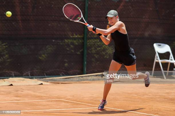 Kaylah McPhee of Australia hits a return during her women's singles quarterfinal match against Chihiro Muramatsu of Japan at the Kunming Open tennis...