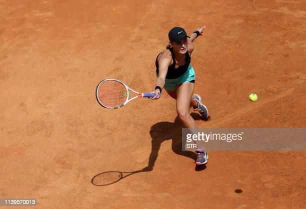 Kaylah McPhee of Australia hits a return during her women's singles semifinal match against Zheng Saisai of China at the Kunming Open tennis...